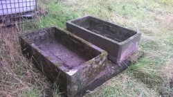 old concrete cattle drinking troughs