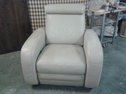 Cream leather  recliner in very good condition