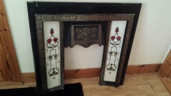 Fire surround with tile inserts