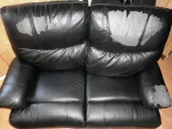 2x Twoseater leather effect manual recliner sofas in Black