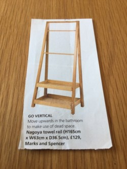 Marks and Spencer vertical oak towel rail with 2 boxed shelves.