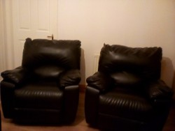 2 black leather recliners