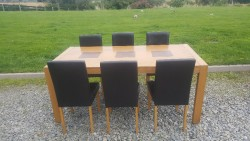 Table with 6 brown leather chairs