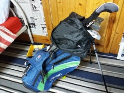 Boys golf clubs and bag.