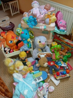 Bundle of toys including dolls cloths shoes Annabelle changing station and chair etc