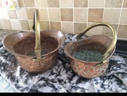 Two antique helmet copper log buckets