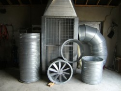 Extraction fan with filter complete with ducting, as new.