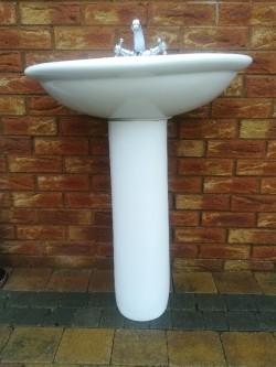 White sink pedestal and taps