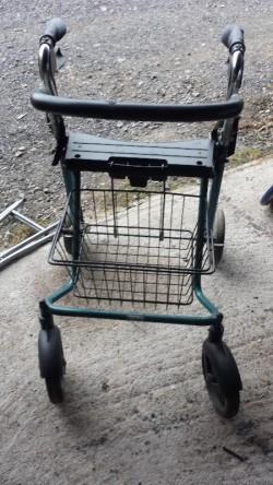 Disability rollator walking aid.