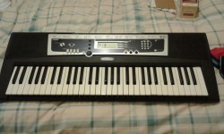 Yamaha Portatone keyboard. Immaculate. Still with box.