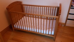 Wooden cot with matress included