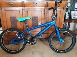 Child's blue stunt bike