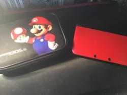 Nintendo 3DS XL Red W/ Free Mario Game and Case- Fabulous Condition with no marks