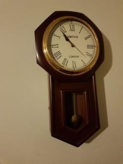 As new Smiths mahogany  battery clock