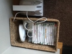 Wii console complete with charger and various games and 2 handsets