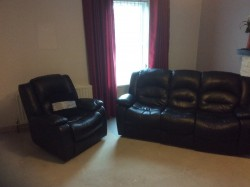3 seater and two single chairs black leather suite