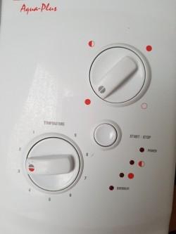 2 Heatstore Aquaplus Electric showers