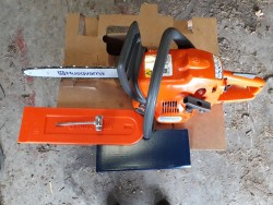 Husqvarna Chainsaw with 14'' Bar.