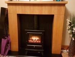 Adam 2kw electric stove and oak fire surround