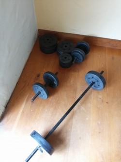 Gym equipment (Bench press, Dumbbells)