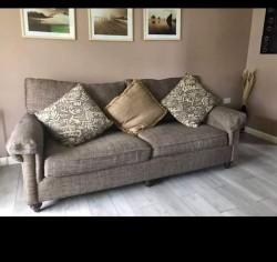 Bassett three seat sofa and poufee