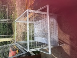 Dog cage on wheels