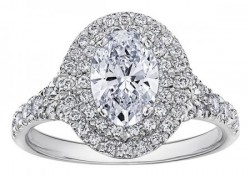 Oval Halo Style Solitaire with diamond shoulders .70ct