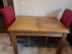 Extending Table & (4) Chairs Red leather.