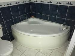 Bathroom suite for sale CORNER BATH, BATH PANEL, TAPS ETC, SINK, TOILET Good Used Condition