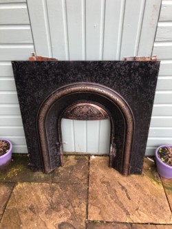 Cast iron fire place insert surround